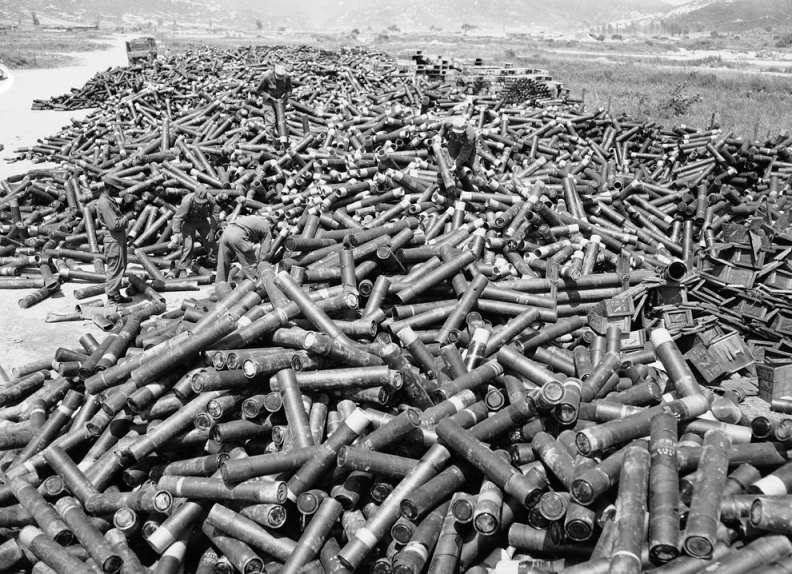 https://ongenocide.files.wordpress.com/2013/04/koreanwarartillerycasings.jpg